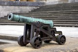 field cannon in front of stairs. weapon for war. field artillary poster