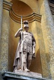 statue of a Greek soldier holding a spear & wearing helmet poster