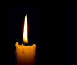 candle flame over black background with copyspace poster