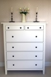 furniture.cupboard/chest of drawers.candles.vase of flowers poster