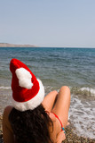young sexy santa girl in the sea poster