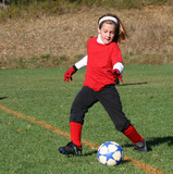 Youth Soccer or Football Player in Action poster