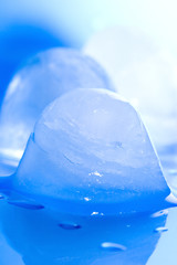 ice cubes on a blue background