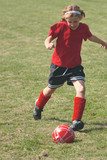 Youth Soccer or Football Player in Action 7 poster
