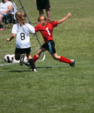 Youth Soccer or Football Player in Action 12 poster