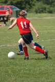 Youth Teen Chasing Soccer Ball on Field poster