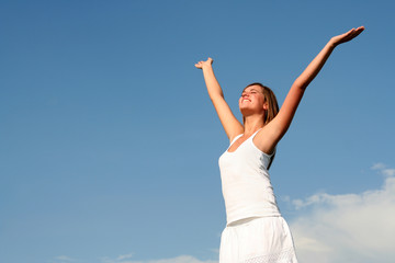 Woman raising arms above her head