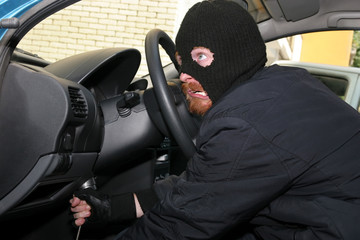 burglar wearing a mask (balaclava), details car burglary inside