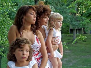 family of four women close up