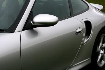 side of silver sportscar