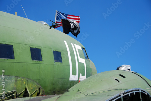 Vintage airplane with pow flag