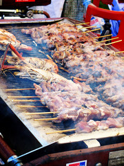 Barbecued prawns and kebabs at festival