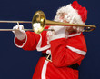 Santa playing the trombone christmas carols loudly