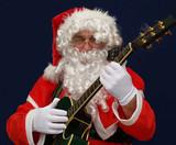 Santa playing christmas carols on guitar
