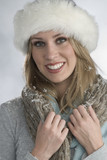 beautiful blonde in winter outfit poster