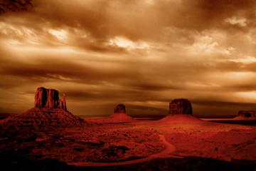 Dark storms hovering at Monument Valley