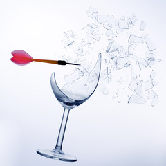 a red arrow splintering a wine glass
