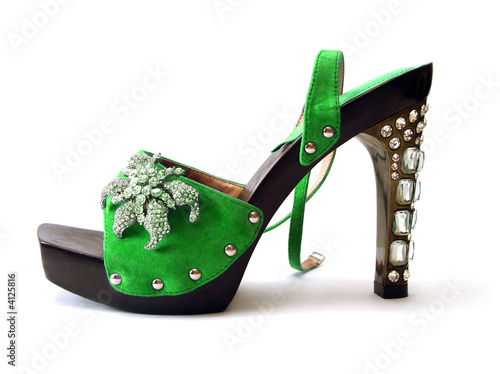 beautiful green woman shoes with brilliant isolated on white bac