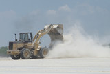 Wheel loader and dust poster