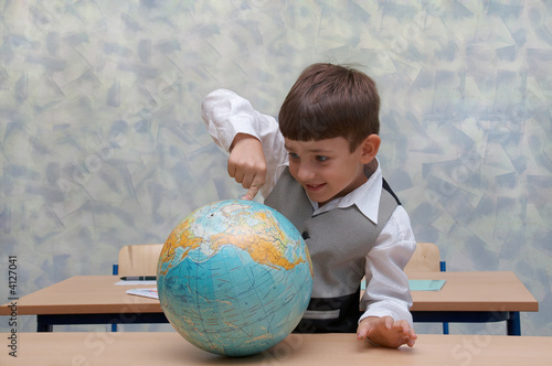 Elementary school. Schoolboy with globe
