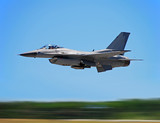 Modern jetfighter F-16 at high speed (motion blur) poster
