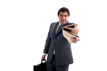 young businessman with a suitcase and a newspaper