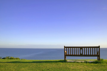Empty bench looking out to sea.
