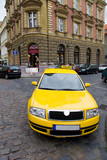 Fototapety Yellow taxi wide angle view