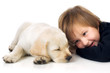 Child next to puppy