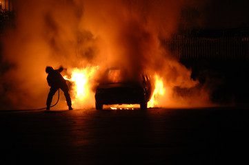 Fire Fighter in Car Blaze