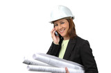 Female contractor on the cell phone holding blue prints poster