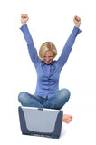 Attractive excited  blond with laptop poster