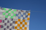 Patchwork counterpane on a clothes-line poster