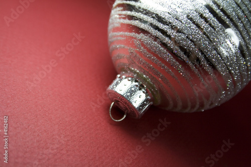 Silver Christmas Ornament on Red Background