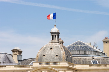 French flag on a building spire