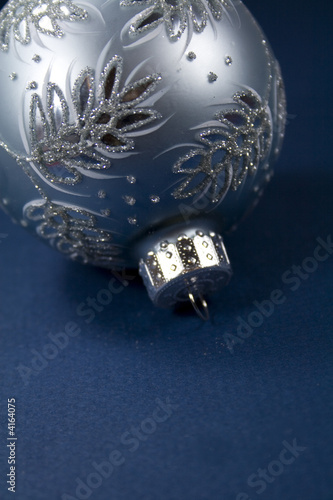 Silver Christmas Ornament on Blue Background 01
