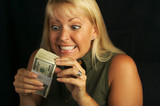 Excited Woman Holding Stack of Money poster