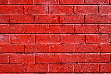 Red painted brick wall