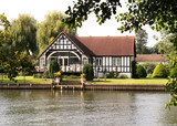 Timber Framed House on the banks of the River Thames poster