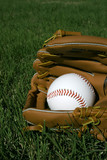 Baseball and Glove in Grass