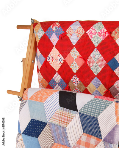 Two Quilts On A Wood Rack - 4174208