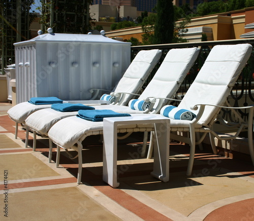 Three White Lounge Chairs Sitting Empty By The Swimming Pool By Nextrecord Royalty Free Stock