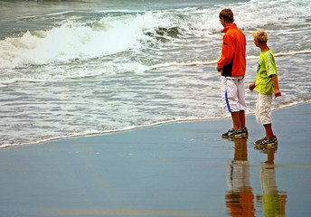 Two boys by the shore