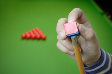 Pool player preparing for a game