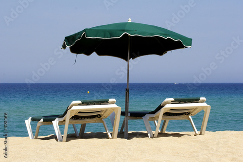 sun lounger on sandy beach