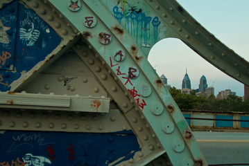 Grafitti on South street Bridge w center city background