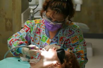 Dental Hygenist working on a patient