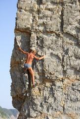Mountaineer on the plumb rock