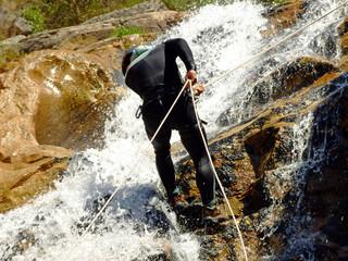 Men descending on rappel