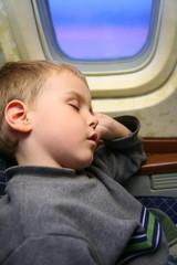 boy sleeping in the airplane